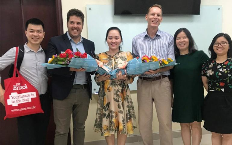UWE representatives receiving thankful bouquets from TDTU Faculty of Accounting